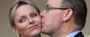 Prince Albert of Monaco kisses his new b