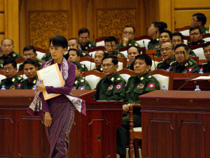 Aung San Suu Kyi walks to her oath at the lower house of parliament Burma