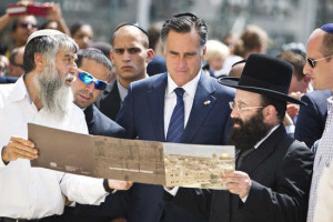 U.S. Republican presidential candidate Romney stands with Rabbi Rabinovitz during his visit at the Western Wall in Jerusalem