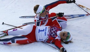 Winner Falla of Norway and her team mate, second placed Oestberg celebrate after competing in the women's cross-country sprint free final at the Sochi 2014 Winter Olympic Games in Rosa Khutor