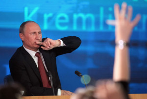 Russian President Vladimir Putin gives a major news conference for Russian and foreign journalists