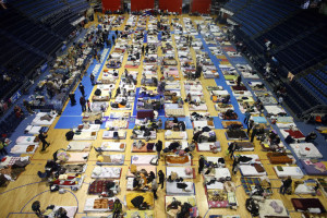 Evacuees from Serbian town of Obrenovac are seen lying on beds in a shelter hall in Belgrade