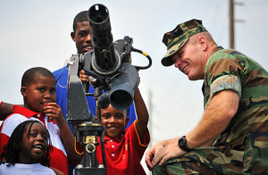 US_Navy_100508-N-7367K-004_Children_visit_a_static_display_of_an_M-134D_Gatling_Gun_during_Seabee_Day_at_Naval_Construction_Battalion_Center_Gulfport