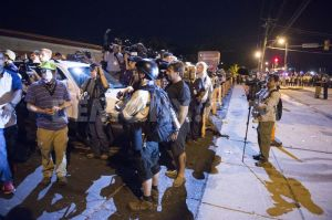 1408535931-media-circus-in-ferguson-after-peaceful-day-turns-into-chaos-missouri_5562423