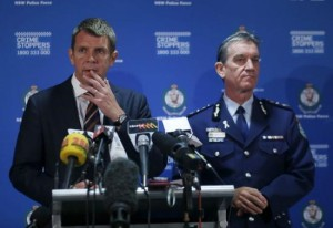 New South Wales Police Commissioner Andrew Scipione and New South Wales Premiere Mike Baird conduct a press conference related to the siege at a Sydney cafe
