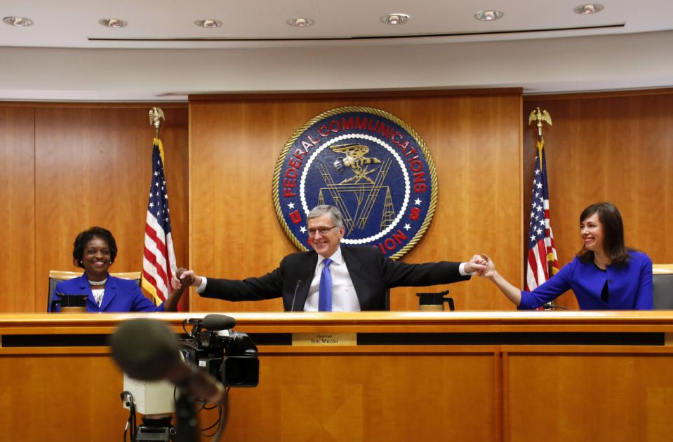 Federal Communications Commission Chairman Tom Wheeler greets commissioners Mignon Clyburn and Jessica Rosenworcel at the FCC Net Neutrality hearing in Washington