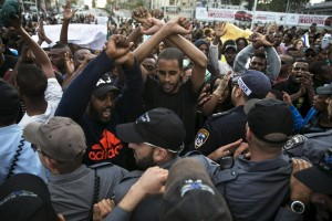 Protesters, mainly whom are Israeli Jews of Ethiopian origin, shout slogans during a demonstration against what they say is police racism and brutality