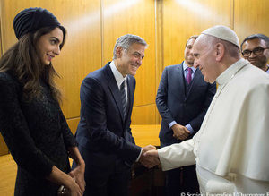 Pope Francis meets US actor Clooney and his wife Amal during a meeting of the Scholas Occurrentes at the Vatican