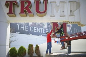 Williams, of Calvi Electric, lowers the 'M' letter from the signage of Trump Plaza Casino to his co-workers in Atlantic City, New Jersey